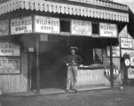 Man in front of Wild West Show shop