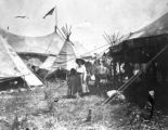 Young woman and girl in Wild West Show camp