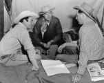 Planning the rodeo Montie Montana, General Sage Kester, and Wayne Van Vleet.