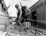 Soldier boarding transport ship