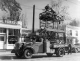 Denver Tramway Corp line truck # T-54 on South Pearl St 1500 blk installing trolley coach wires