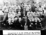 Gillpatrick is in the center of this picture with two ball players on either side of him.