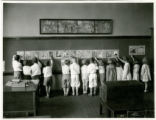 Washington Park School students along chalk boards