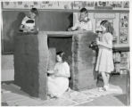 University Park School students building adobe hut