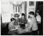 Byers Junior High students buying war savings stamps