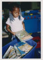 Ford-Warren Branch Head Start student at book tub