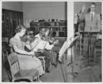 Morey Junior High Students taking violin lessons