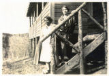 Two women stand on the stairs of Winks Panorama (Wink's Lodge)