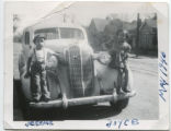 Cary (Carey) children standing on car