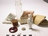 Artifacts from archaeology excavation of History Colorado site: ceramic shards bottle, metal...