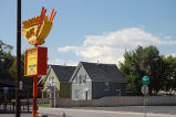Southwest corner of Yates and West Colfax Avenue, Sidewok Café sign and residential housing