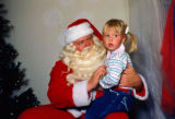 Child with Santa Claus at Mission Viejo