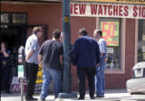 (Denver,Co., April 26, 2004)  Police interview people after a clerk was shot  at the Central...