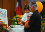 Yariah Santistevan, 2, and her grand-father Eloy Trujillo, Jr.(cq) view brother Deion Santistevan,...