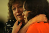 Debra Vasquez(cq), left of Westminster, and Linda Cordova(cq), of Denver, embrace after seeing...