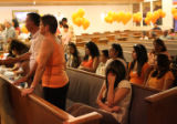 Bianca Olmos, 17 foreground, weeps during the viewing for her cousin Deion Santistevan, 5, at...
