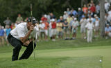 Tom Lehman lines up a birdie putt that he missed which opened the door for Dean Wilson to make...