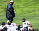 JPM350 Denver Broncos defensive end Kenard Lang, #76, talks to defensive line/tackles coach Andre...