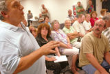 KAS087 Jim Provenzano (cq), a retired business owner, speaks during a town hall meeting about the...