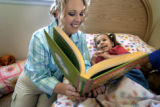(DENVER, Colo., May 6, 2004)  Tammi Rawlins reads a nap time story to her youngest daughter...