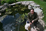 (sen) -- Architect Mike Bensky (cq) by a pond in the courtyard  Wednesday afternoon August 9, 2006...