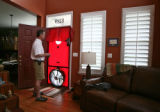 Steve Byers (cq) uses a Blower Door during his energy efficient house testing for the...