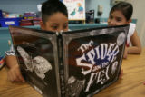 "Fourth-grader Alejandro Mata, left, and third-grader Cassidy Quintana read the ""The Spider..."