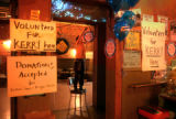 Seattle, Washington-Gwen Scott, Seattle, hangs Kerry signs at the Tractor Tavern in Seattle's...