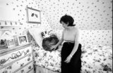 Patsy Ramsey sits in JonBenet Ramsey's bedroom in one of the family's homes Saturday, Aug. 16,...