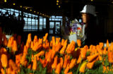 Seattle, Washington-Lee Cha, who moved to the U.S. from Laos 13 years ago, arranges flowers at...
