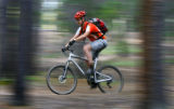 M.O. Alford (cq), 35, of Nederland rides on the Hobbit Trail 1 in the West Magnolia Trail System...