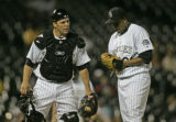 Colorado Rockies' catcher Danny Ardoin, left, tries to give pitcher Ramon Ramirez  a pep talk...