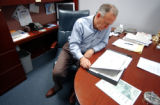 Charlevoix, MI, May 6, 2004-- John Ramsey signs campaign letters in his office located in the...