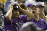 Colorado Rockies' fans watch as pitcher Ramon Ramirez gave up what would become the winning run to...