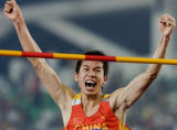 XHG102 - China's Huang Haiqiang celebrates his victory after clinching the gold medal at the Men's...