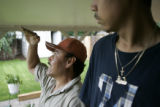 Samuel Hernandez, CQ, 48, left, and his son Jesus Hernandez discuss what their plans for the...