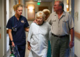 Nursing student Renee Hartman (cq), 31, left, walks with patient Agnes Kramer (cq), 79, and her...