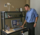 Kyle Seaser (cq) checks over a desk in apartments for rent in the Inn At Auraria, 14th and...