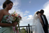 Lindsey Welsh, cq, left, bows her head in prayer during her brother David Welsh's, cq, wedding to...