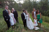 Members of the band The Fray pose for photographs with their wives after the wedding ceremony for...