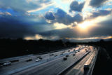 MJM1873  Rush hour traffic begins to wind down as the sun breaks through the clouds Wednesday to...