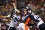 08/19/2006 Denver Broncos Jay Culter, #6, passes under pressure from Tennessee Titans Randy...