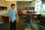 John Temple - Rocky Mountain News editor, publisher and president - moves in to his new office...