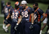 Denver Bronco Tight ends #83, Mike Leach, #88 Tony Scheffler and #89 Nate Jackson  run drills...
