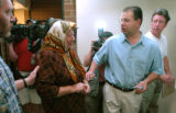 (DENVER, COLO., MAY 6, 2004)  Kazwan Mahmoud Elias, right, leads his mother, Tharmara Mahmood al...