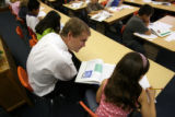 MJM567  DPS Superintendent Michael Bennet visits with students in the library on the first day of...
