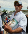 Eloy Trujillo(cq)  holds photos of his grandson Deion Santistevan , 5, outside the Woodstream...