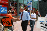 Ed Osborne, cq, shakes the hand of Colorado gubernatorial candidate Bill Ritter as he walks along...