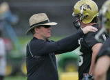 Dan Hawkins new head football coach of the University of Colorado football team, left, talks with...