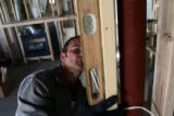 Steven Rechsteiner, owner of Rechsteiner Home Improvements out of Parker, checks the plumb on a...